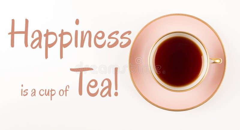 Teezeit zitiert, schönes Rosa und Goldtasse tee, Schuss von oben, Glück ist Tasse Tee, lizenzfreie stockfotografie