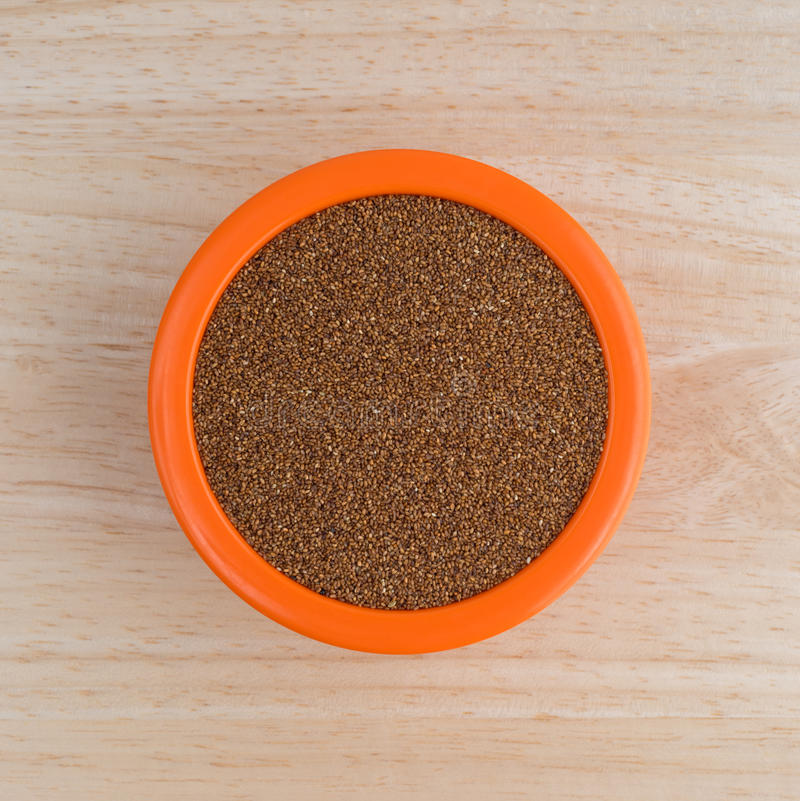 Teff grain filling a small bowl on wood table top royalty free stock photos