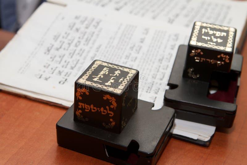 Tefillin and Torah stock photography
