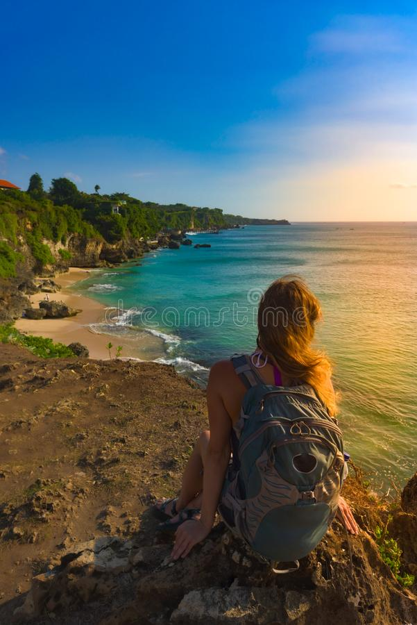 Tourist admires Tegal Wangi Beach Badung Bali Indonesia. Tegal Wangi Beach Badung Bali Indonesia royalty free stock images