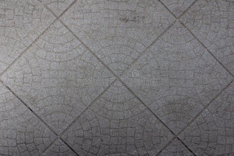 Tegelplattamodell för smutsig pöl Sliten pusseltrottoarbakgrund Abstrakt keramisk tegelstenmodell Duschen ytbehandlar textur arkivbild