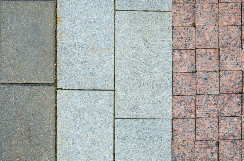 Tegelplattor för granitstentrottoar arkivbilder