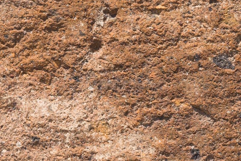 Tegelsten från den gamla rosa tufftexturmakroen, selektiv fokus royaltyfri bild