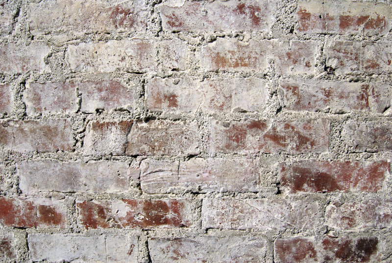 tegelstenar gjorde väggen arkivbilder