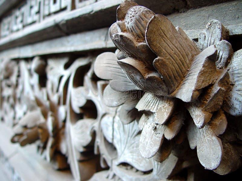 tegelstencarvingslotusblomma royaltyfri fotografi