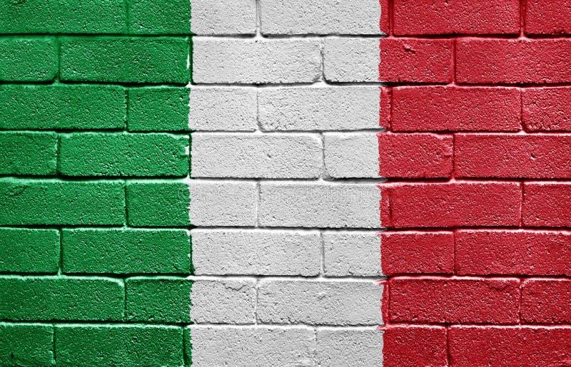 tegelstenflaggaitaly vägg royaltyfri bild