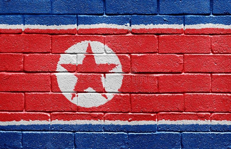 tegelstenflaggakorea norr vägg royaltyfri bild
