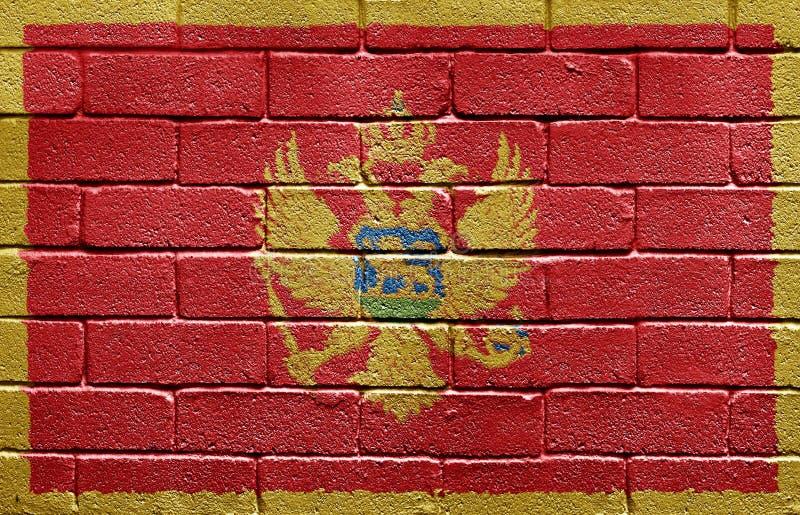 tegelstenflaggamontenegro vägg fotografering för bildbyråer