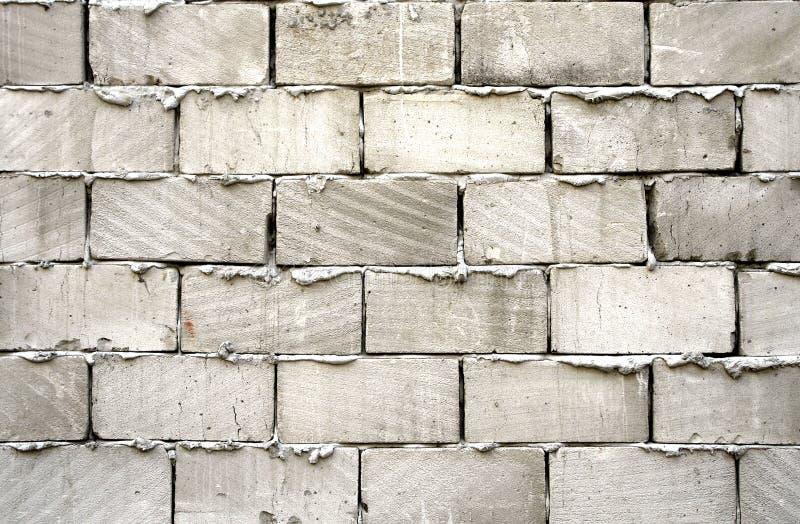 tegelstengreyvägg royaltyfria bilder