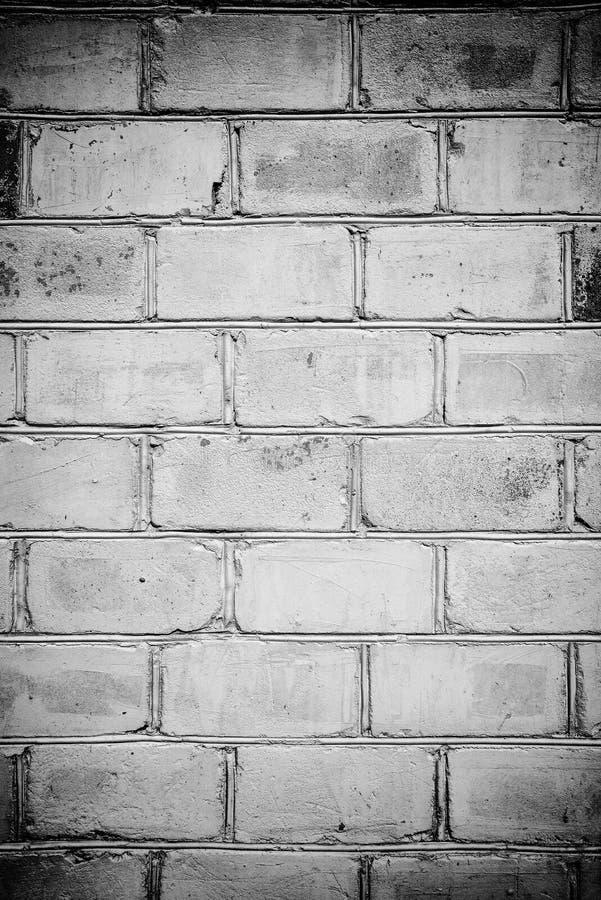 Tegelstenvägg i grungestil, svartvit effekt, tapet eller bakgrund med stället för text royaltyfria foton