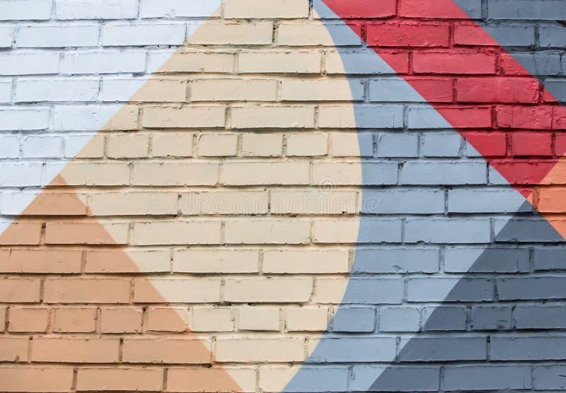 Tegelstenvägg med en abstrakt geometrisk modell fotografering för bildbyråer