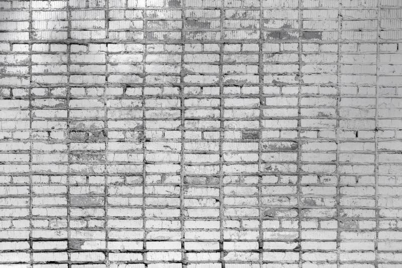 Tegelstenvägg, med fläckar Textur av murverket Härlig tom bakgrund av gråa tegelstenar royaltyfria foton