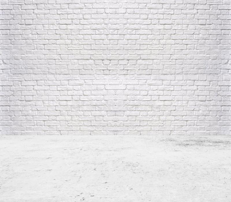 tegelvloer en achtergrond van de baksteen de witte muur royalty-vrije stock afbeelding
