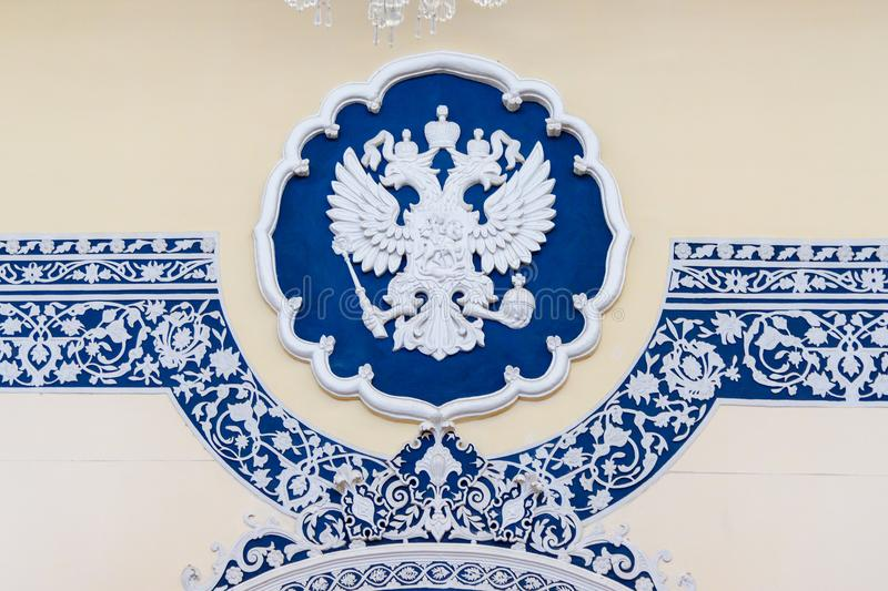 Coat of arms of Russia is Imperial eagle, Russian state emblem in Embassy of Russia Tehran. Iran. Tehran, Iran - March 18, 2018: Coat of arms of Russia is royalty free stock photo