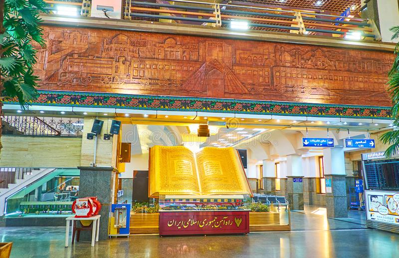 The hall of Tehran Railway Station, Iran. TEHRAN, IRAN - OCTOBER 25, 2017: Interior of main hall of Tehran Railway Station, decorated with relief tile depiction stock photography
