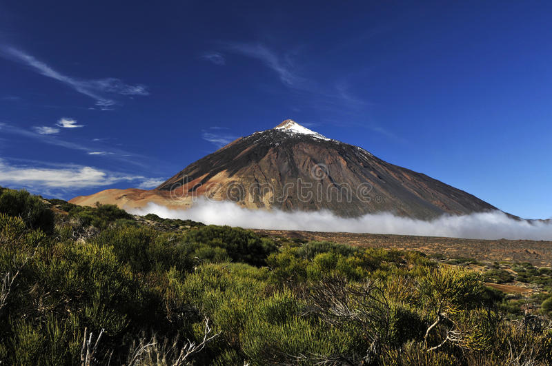 Teide volcano from far. Snow-covered peak of Teide, Tenerife royalty free stock image