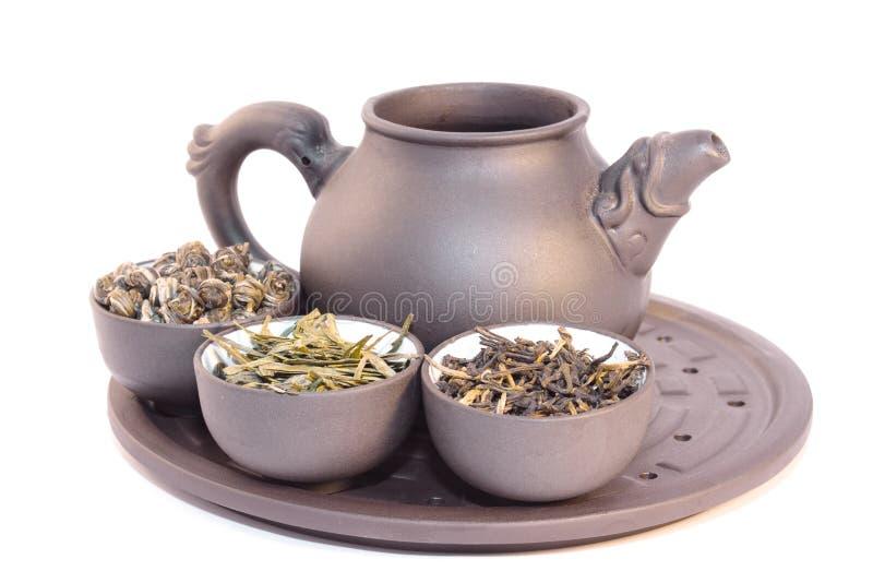 Teiera e tre tazze di tè di erbe. immagine stock libera da diritti