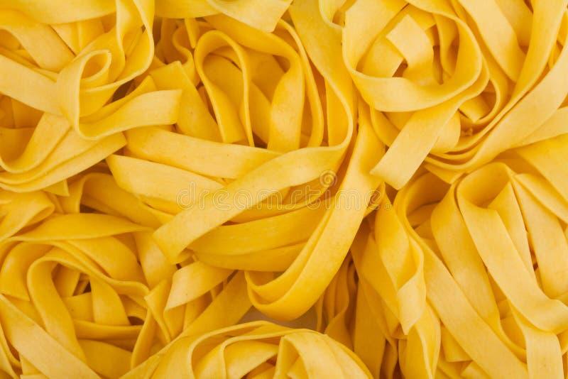 Teigwaren-Beschaffenheitshintergrund der Bandnudeln italienischer stockfotografie