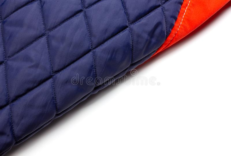 Teil der inneren Seite von einem Roten und ein blau hinunter Jacke lizenzfreies stockbild