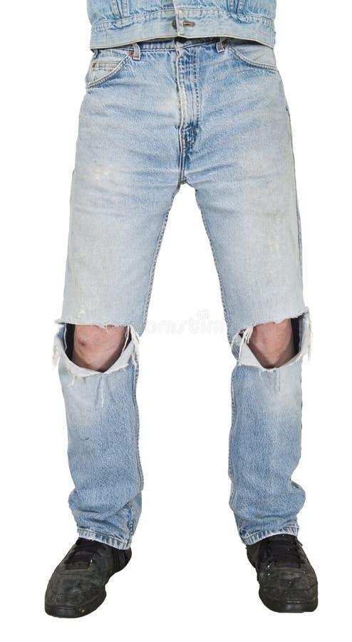 Tejanos, agujeros en rodillas, mirada de Grunge aislada imagen de archivo libre de regalías