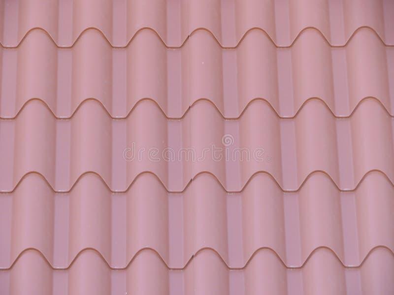 Tejas hermosas para cubrir la casa de la lluvia y del frío imagen de archivo