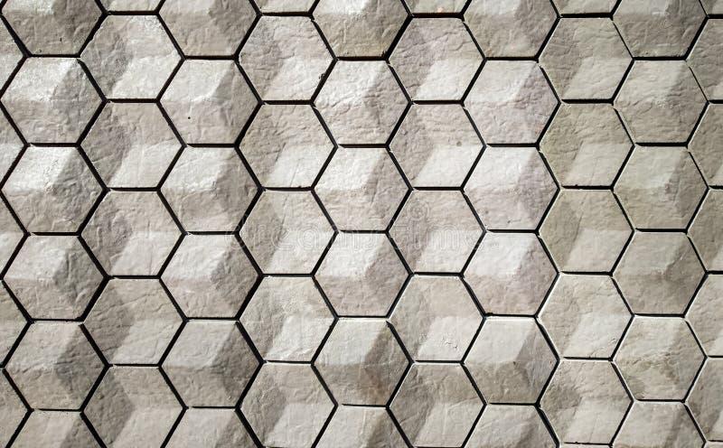 tejas vitrificadas en un modelo geométrico hexagonal con textura gris y blanca imagen de archivo