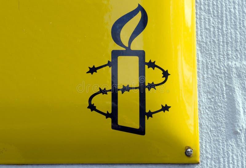 Teken van Amnestie internationaal in Amsterdam i royalty-vrije stock fotografie