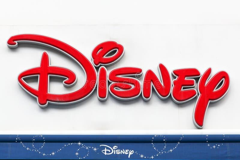 Teken van Disney-opslag op een muur stock afbeelding