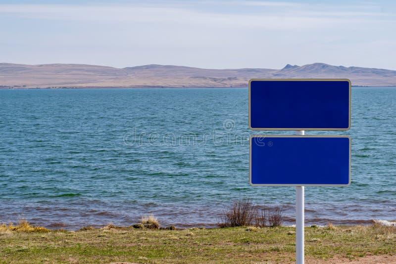 Teken, teken zonder het schrijven op de meerkust royalty-vrije stock afbeeldingen