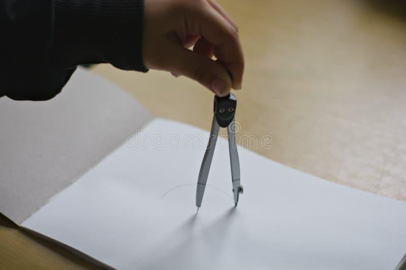 Tekeningscirkel op het document met verdeler royalty-vrije stock foto
