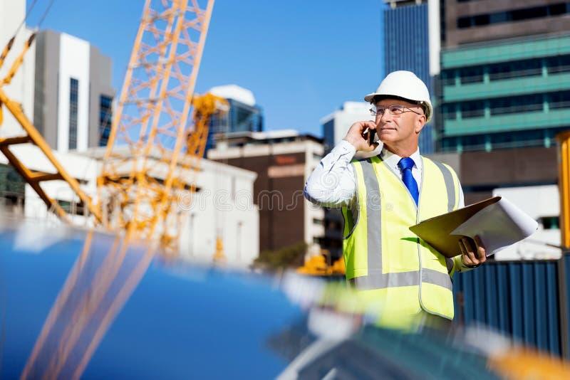 Teknikerbyggmästare på konstruktionsplatsen arkivbild
