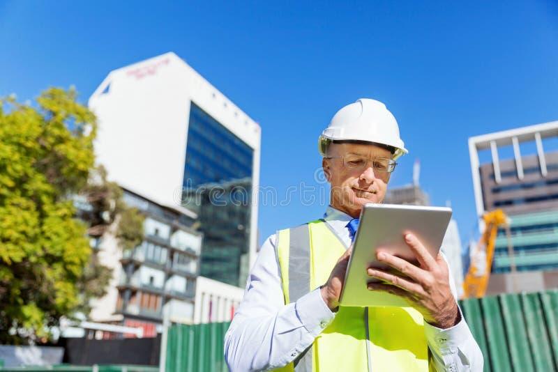 Teknikerbyggmästare på konstruktionsplatsen arkivfoton