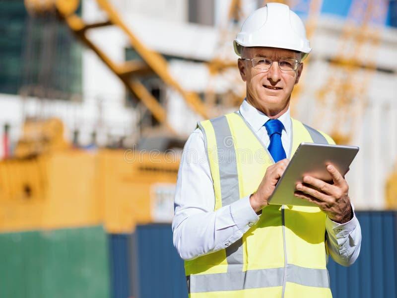 Teknikerbyggmästare på konstruktionsplatsen arkivbilder