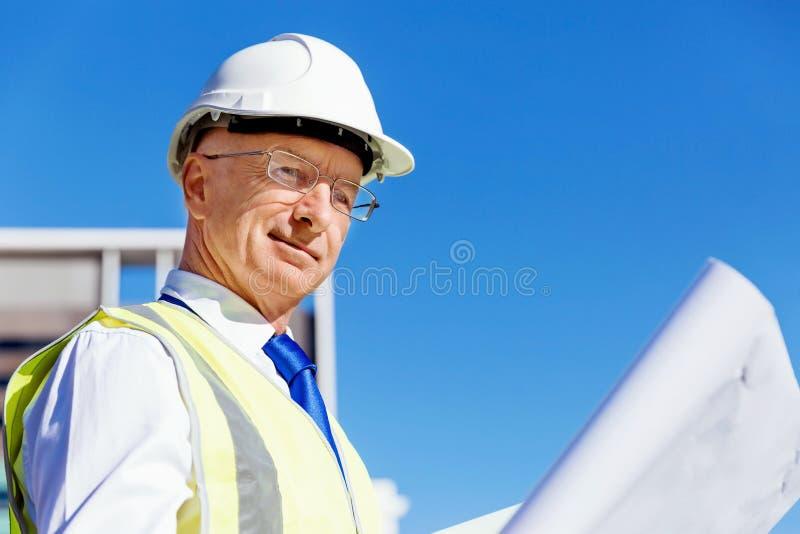 Teknikerbyggmästare på konstruktionsplatsen royaltyfri bild