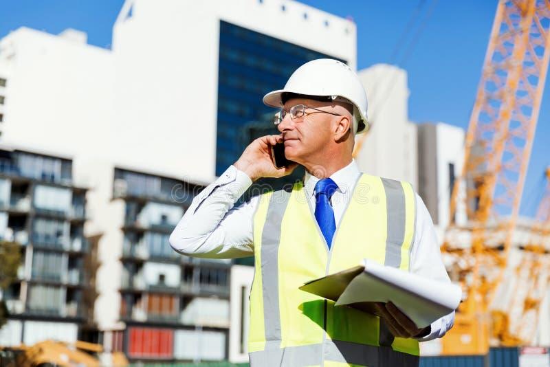 Teknikerbyggmästare på konstruktionsplatsen royaltyfria bilder