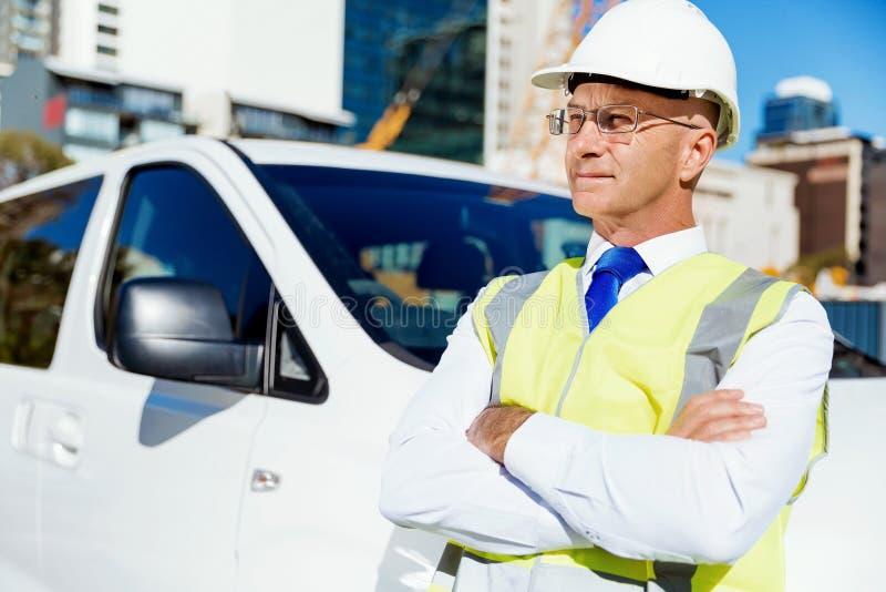 Teknikerbyggmästare på konstruktionsplatsen arkivfoto
