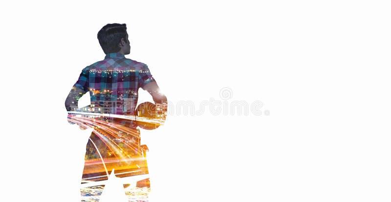 Teknikerman och cityscape Blandat massmedia arkivbild