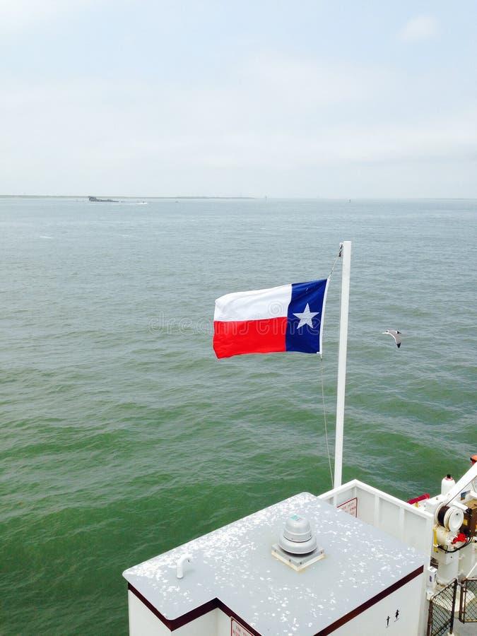 Teksas flaga przy morzem fotografia royalty free