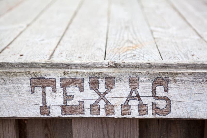 Teksas inskrypcja na drewnianym talerzu obraz stock