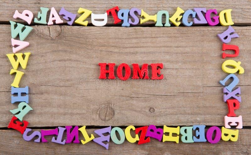 Tekst «Domowy «barwioni drewniani listy zdjęcia royalty free
