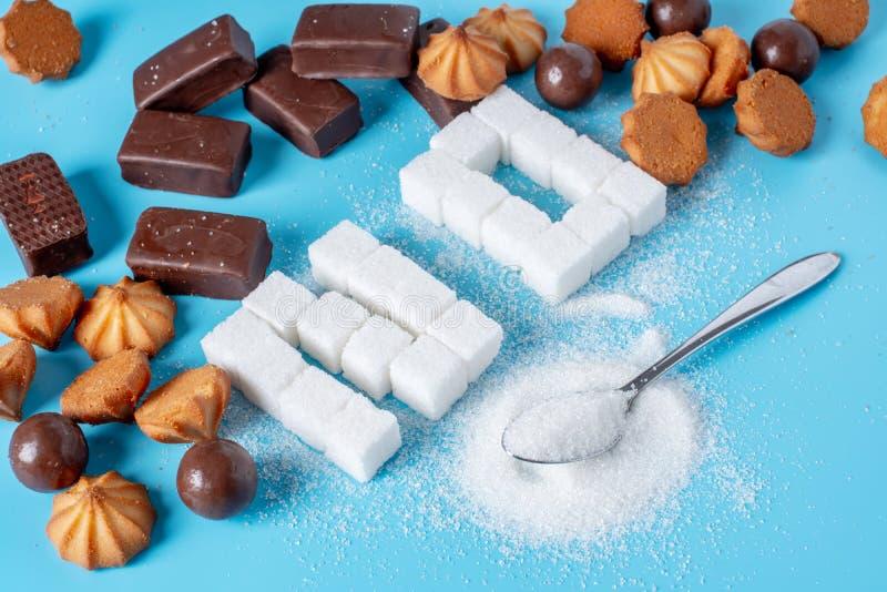 Tekst Żadny wykłada z cukrowymi sześcianami i cukierkami Krzywda zdrowie cukierki i odrzucenie sucrose zdjęcia stock
