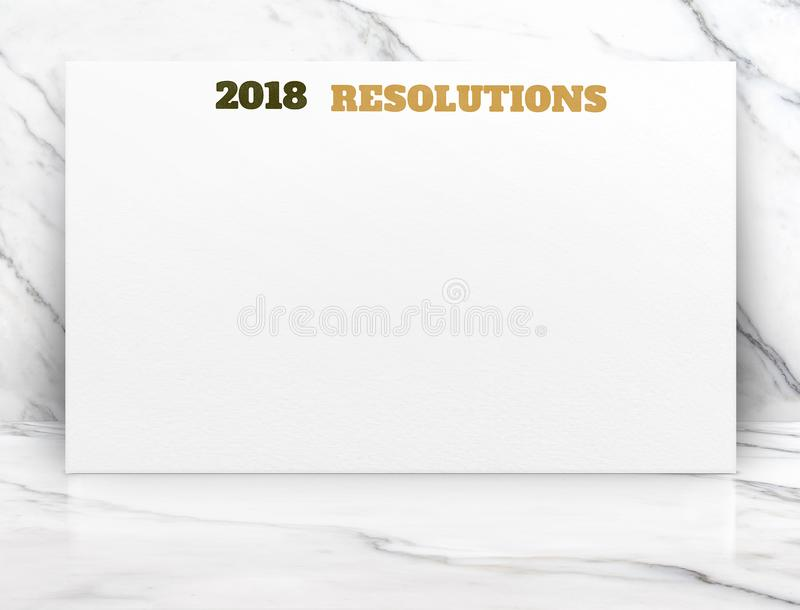 tekst van 2018 de nieuwe jaarresoluties op Witboekaffiche op witte ma stock fotografie
