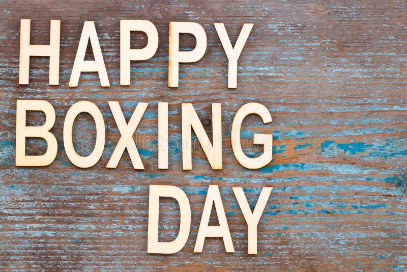 Teksta drugi dzień świąt bożego narodzenia Szczęśliwy słowo na drewnianym tle zdjęcia royalty free