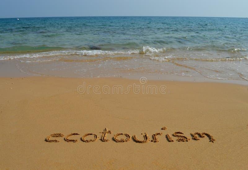Download Teksta ecotourism w piasku obraz stock. Obraz złożonej z słowa - 53783485