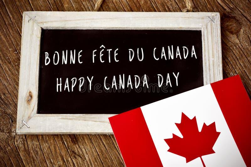 Teksta Kanada Szczęśliwy dzień w Francuskim i Angielskim obraz royalty free