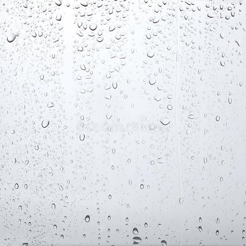 Tekstur krople woda na przejrzystym szkle, abstrakcjonistyczny tło obrazy stock