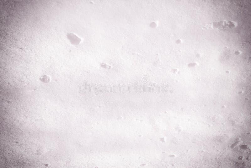 Tekstura świeży biały śnieg z lilym cieniem Abstrakta pusty tło Zabarwiająca fotografia zdjęcie stock