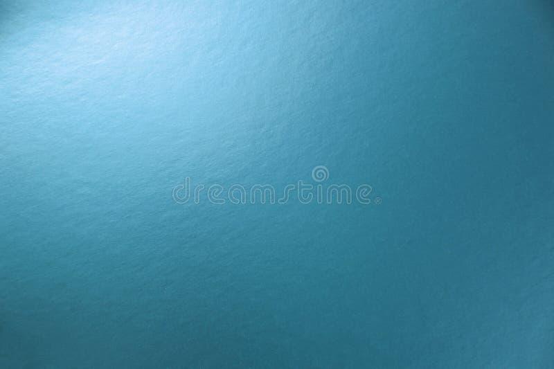 Tekstura błękitny kruszcowy papierowy tło dla projektów bożych narodzeń o obrazy royalty free