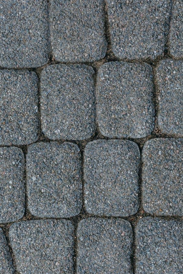 Tekstura brukowy kamienny kamieniarstwo, zamyka up, odgórny widok Zewnętrzny podłogowy nakrycie Bruku tło fotografia royalty free