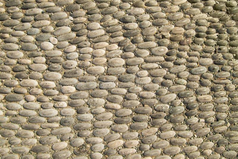 Tekstura chodnika z kamienia żwirowego obraz royalty free